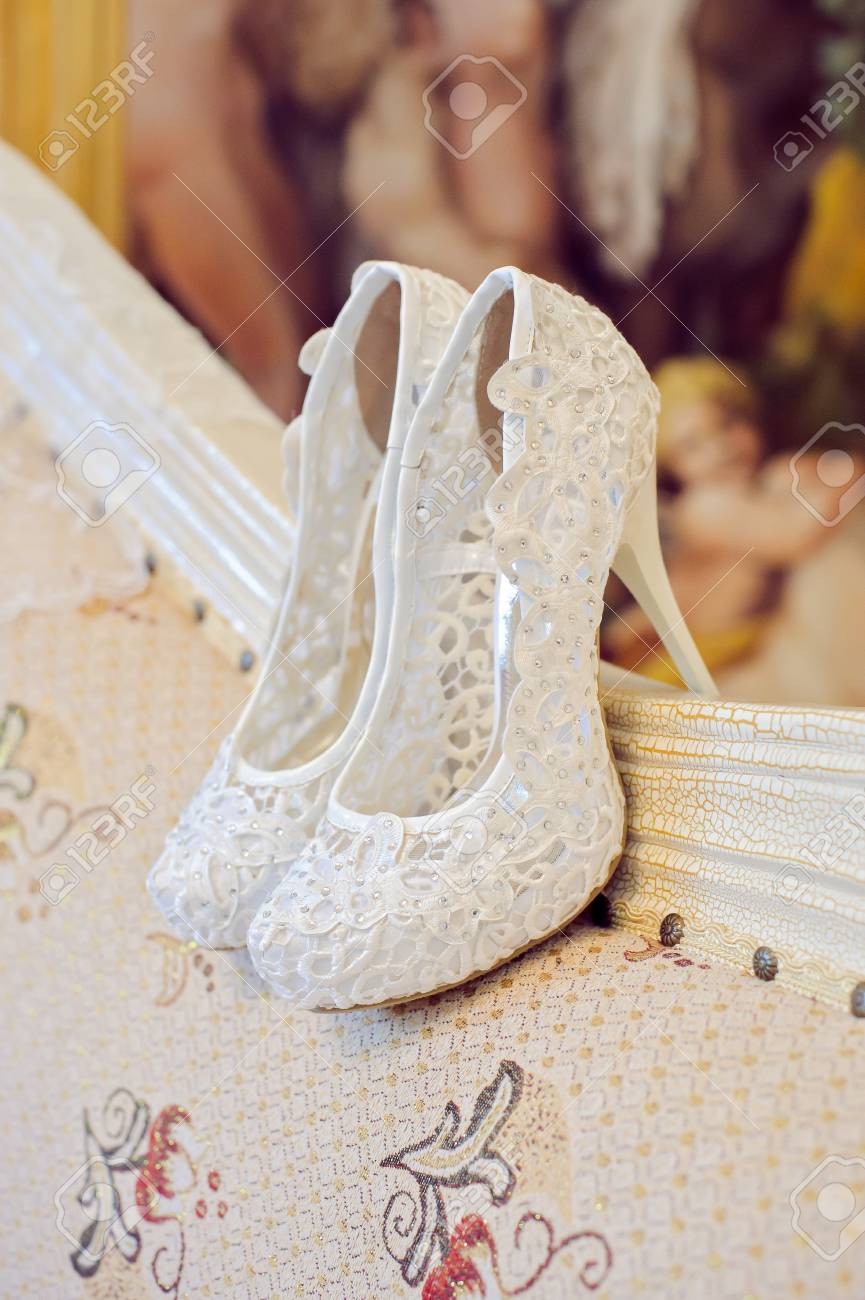 d5fc37286f843 Wedding shoes cream color on the chair at the hotel.