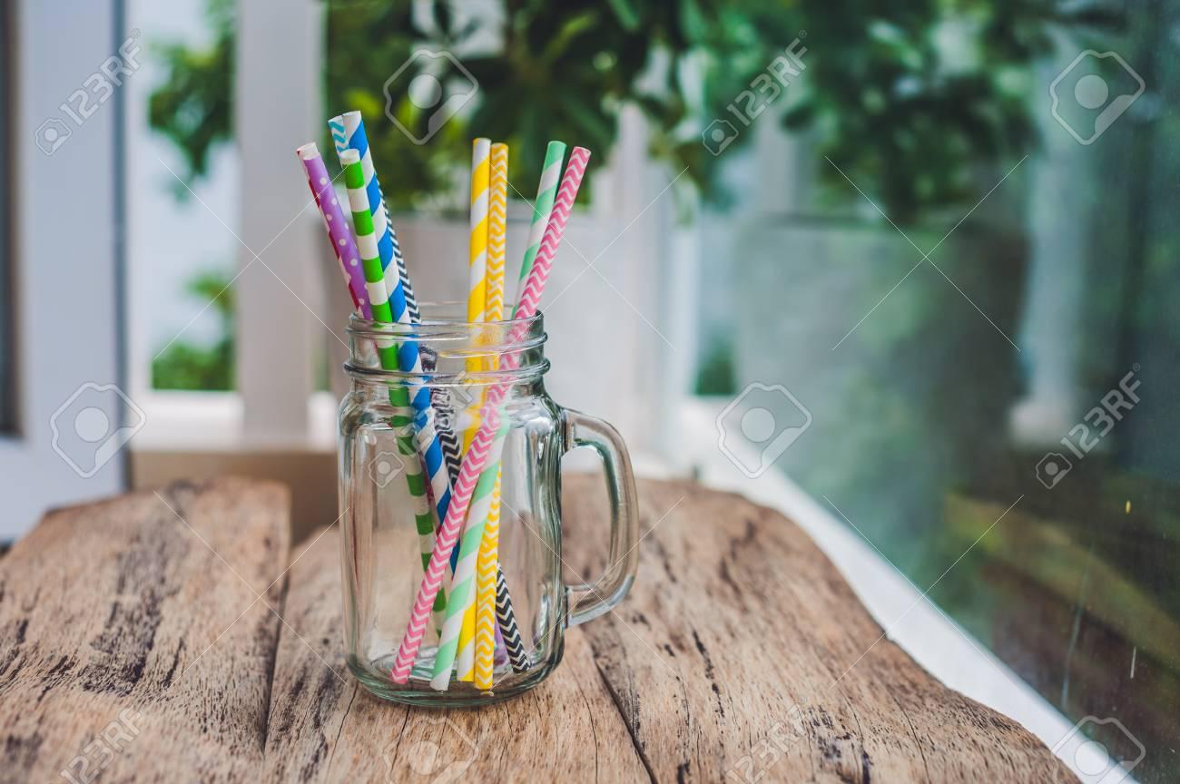 Vintage Mason Jar And Multicolored Spiral Straws Wedding Decor