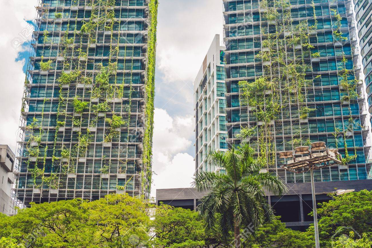 eco architecture green skyscraper building with plants growing