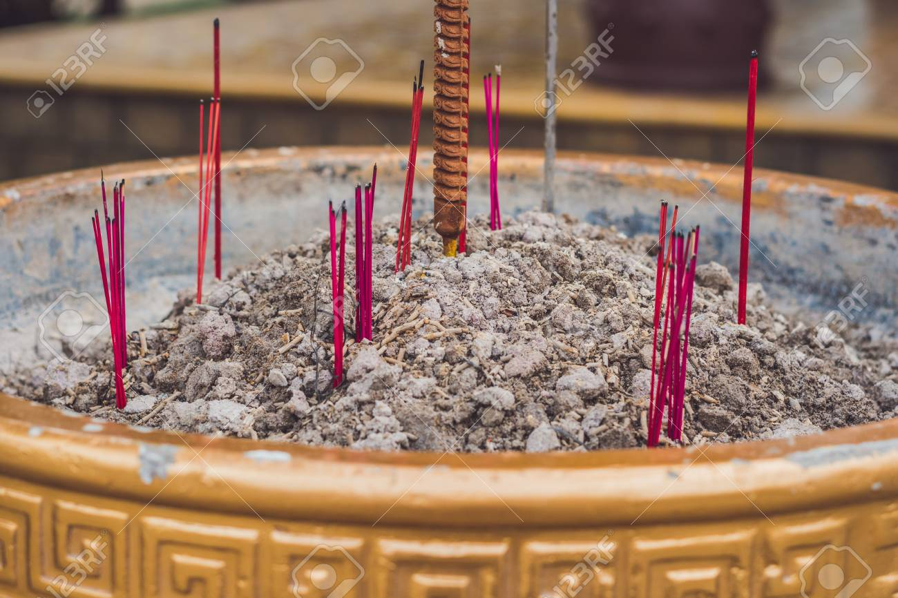 Buddhist prayer sticks inside temple  Incense  Asia Travel concept