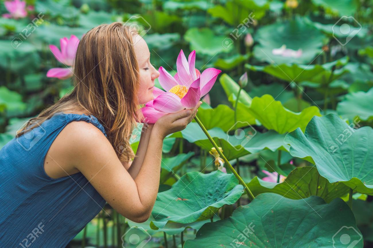 Picture Of Beautiful Woman Red Haired With Lotus Flower In Hand