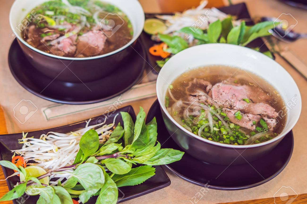 Pho Bo - Vietnamese fresh rice noodle soup with beef, herbs and