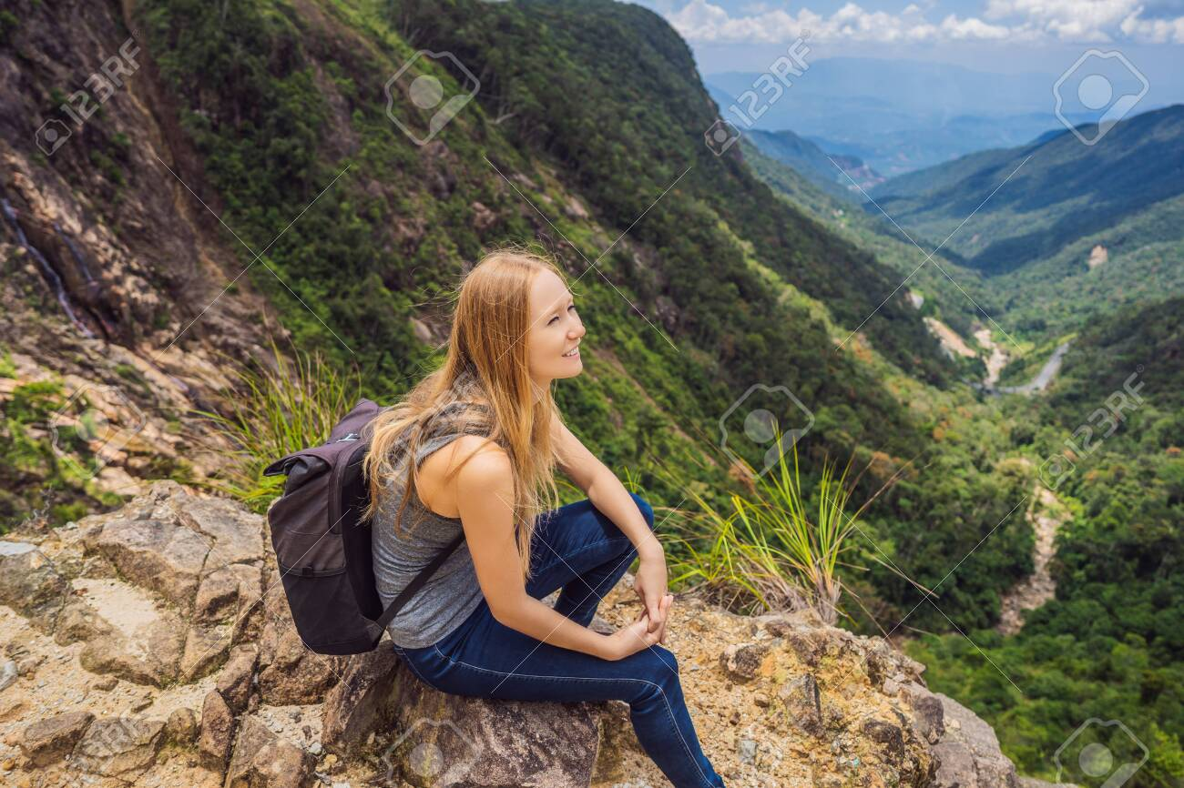 Woman hiker on a rock. View of the valley from the cliff, Vietnam, Da Lat - 150385813
