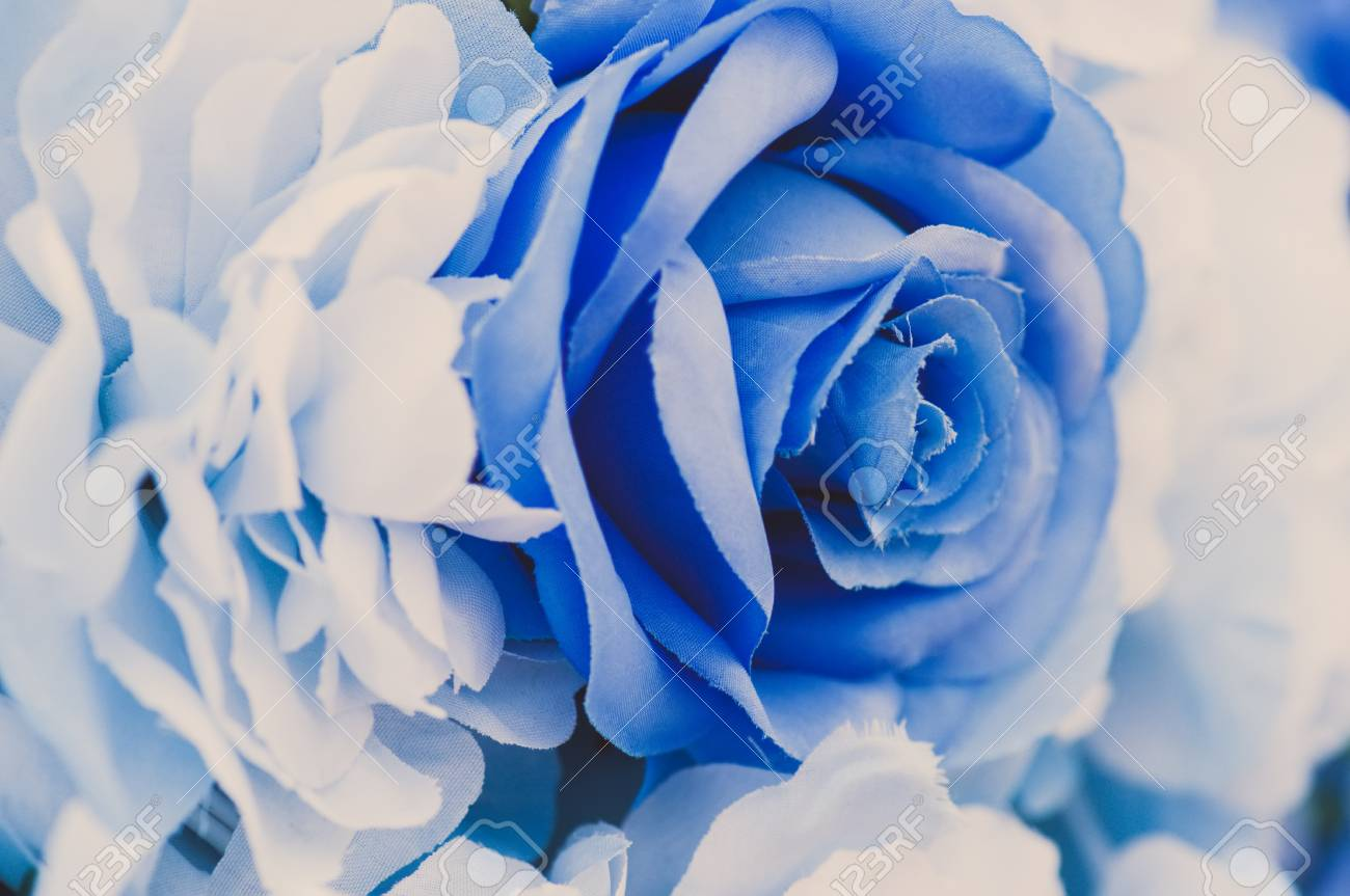 Blue Fake Flowers Background Close Up Texture Toned Stock Photo