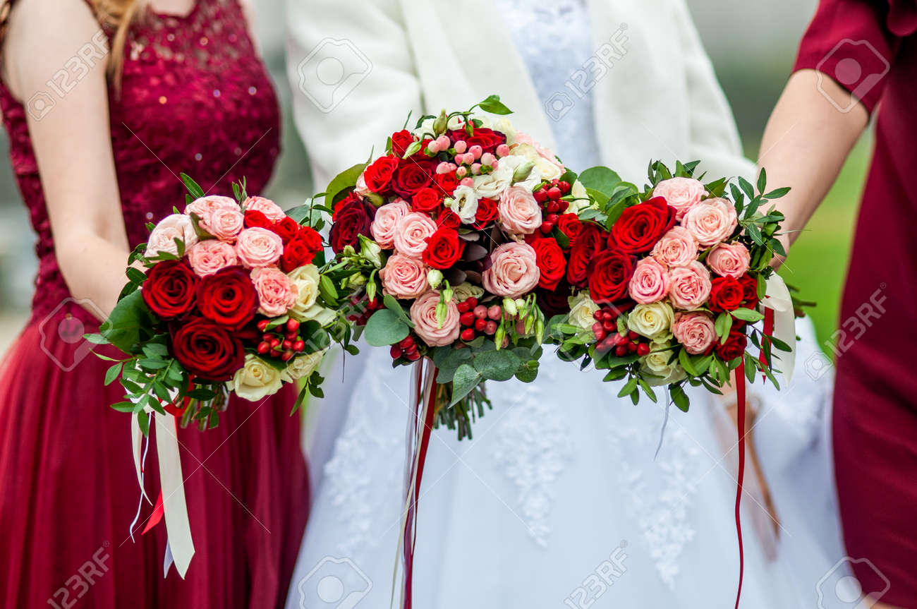Bouquets of flowers in the hands of the bride and bridesmaids - 146222047