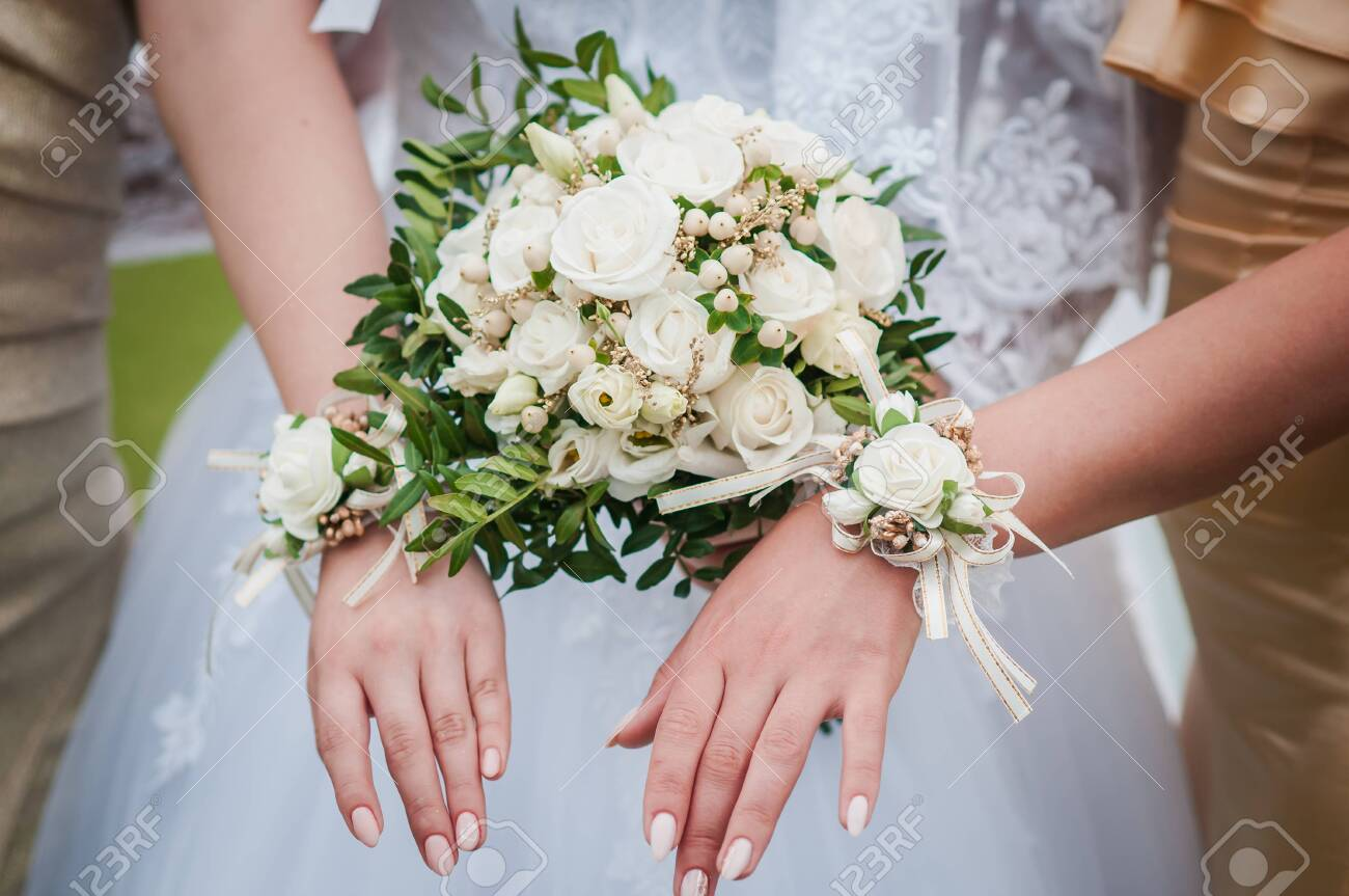 Bouquets of flowers in the hands of the bride and bridesmaids - 146221596