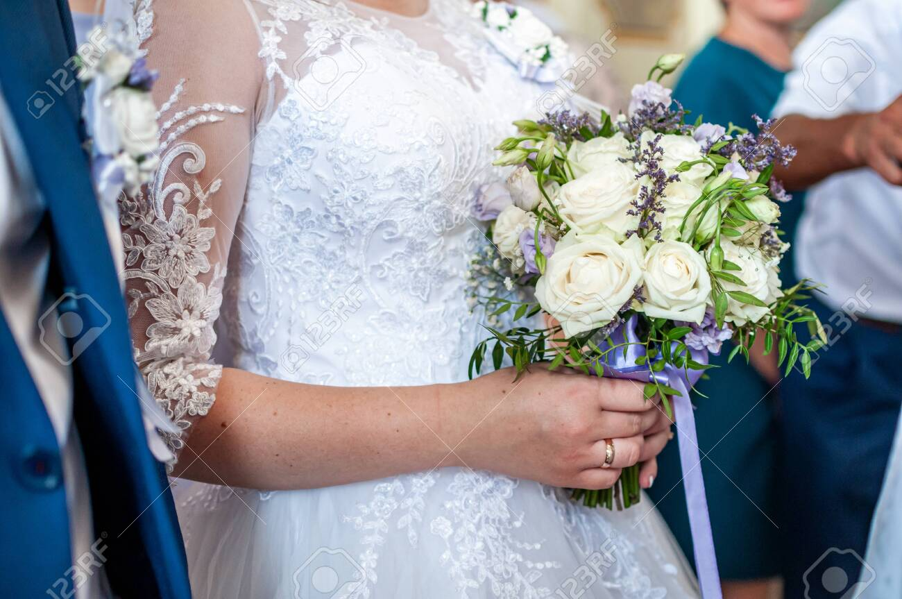 Bouquet of flowers in the hand of the bride - 146221618