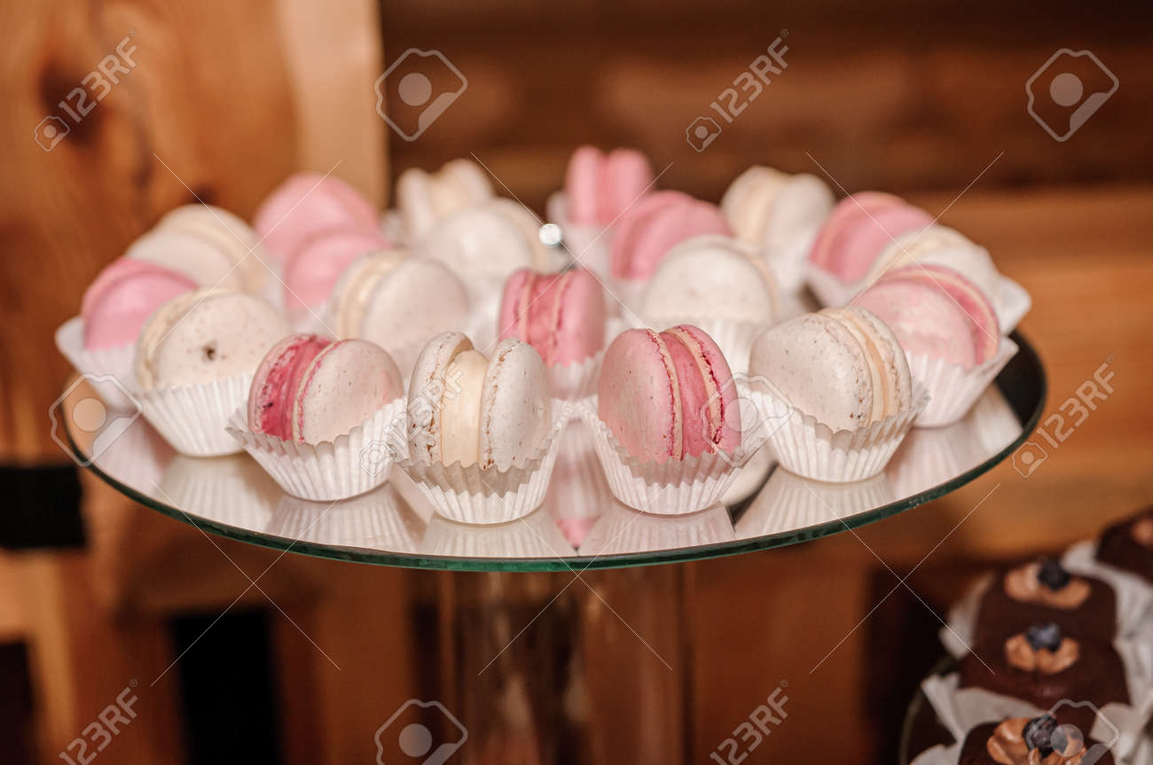 Candy bar with sweet macaroon cakes at a wedding buffet - 165328023