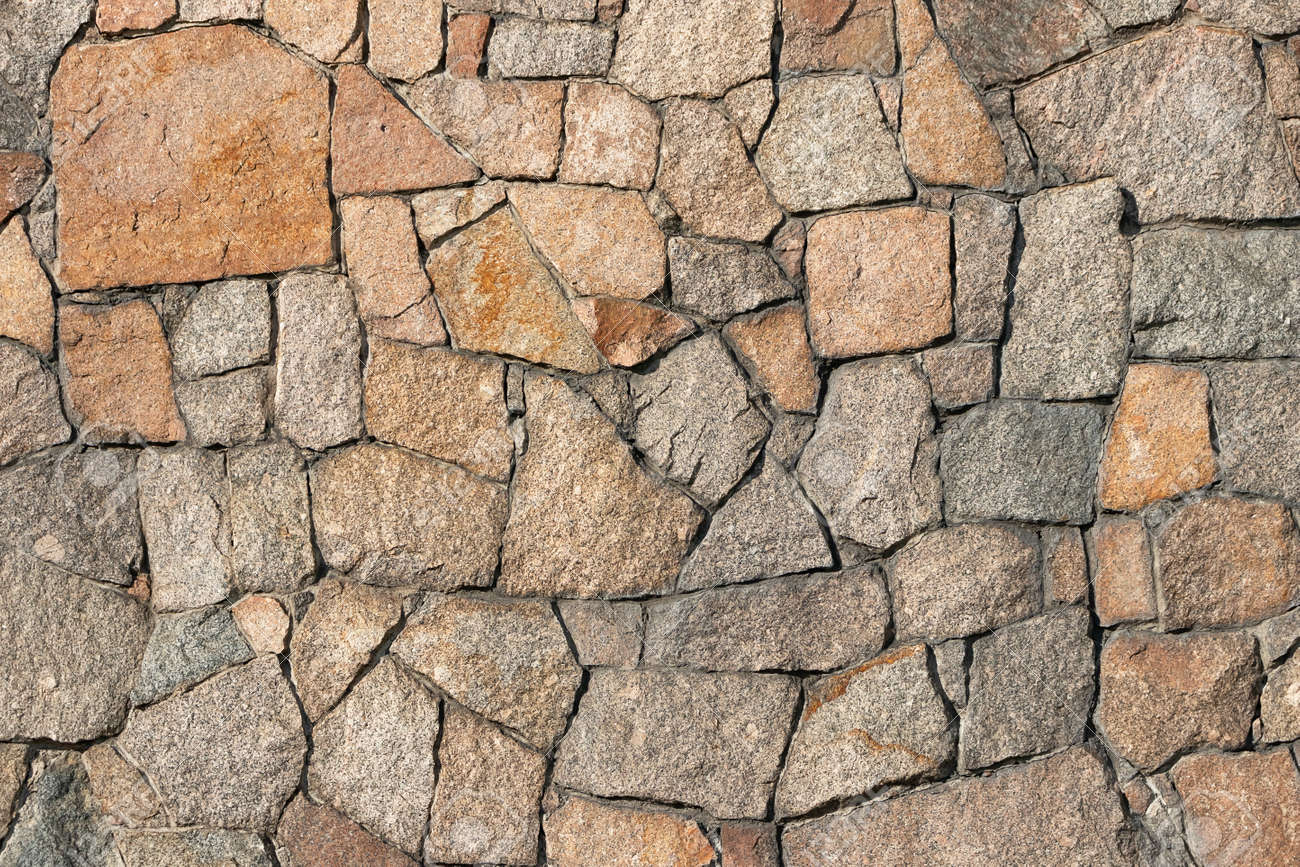 Stone wall of granite close-up, texture, background - 170577194