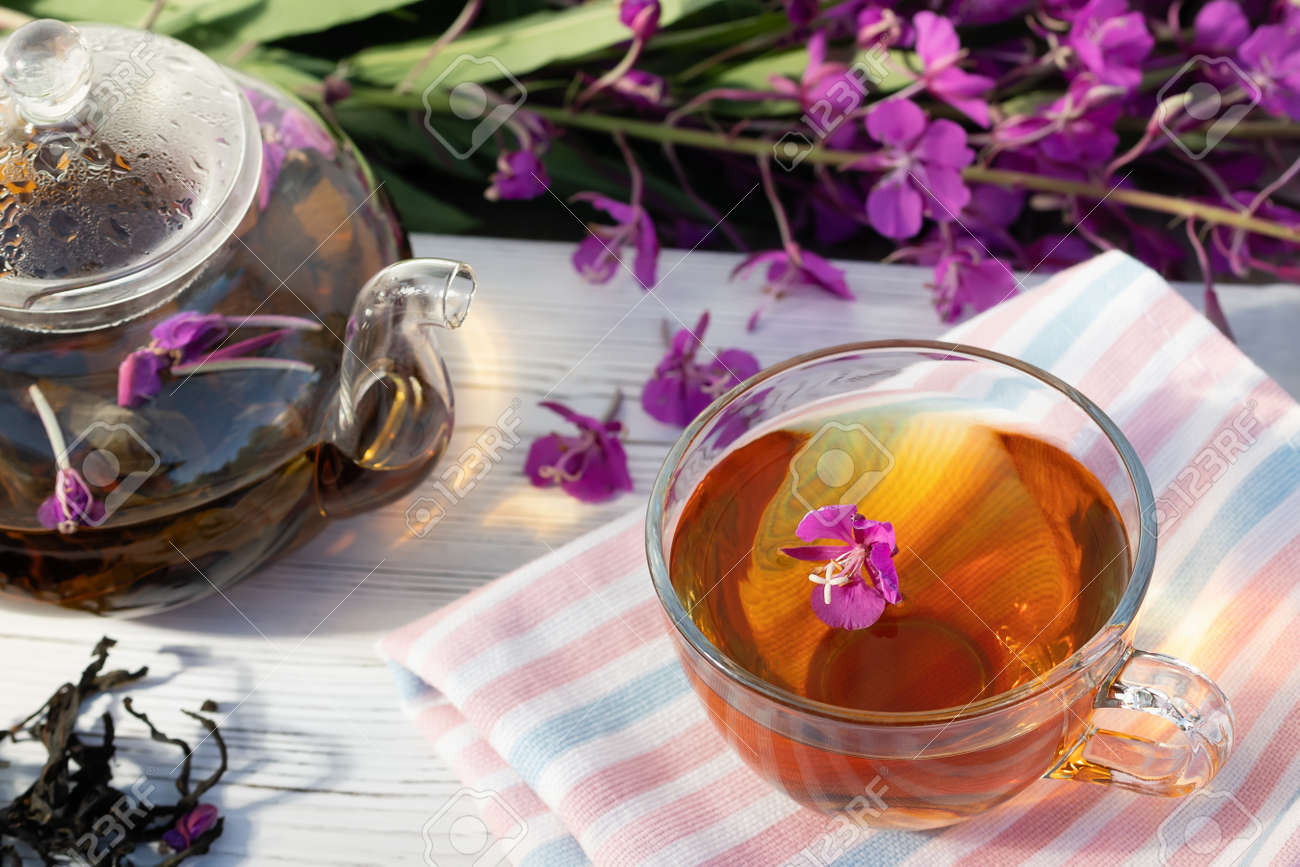 Herbal tea made from fireweed known as blooming sally in teapot and cup - 170577207