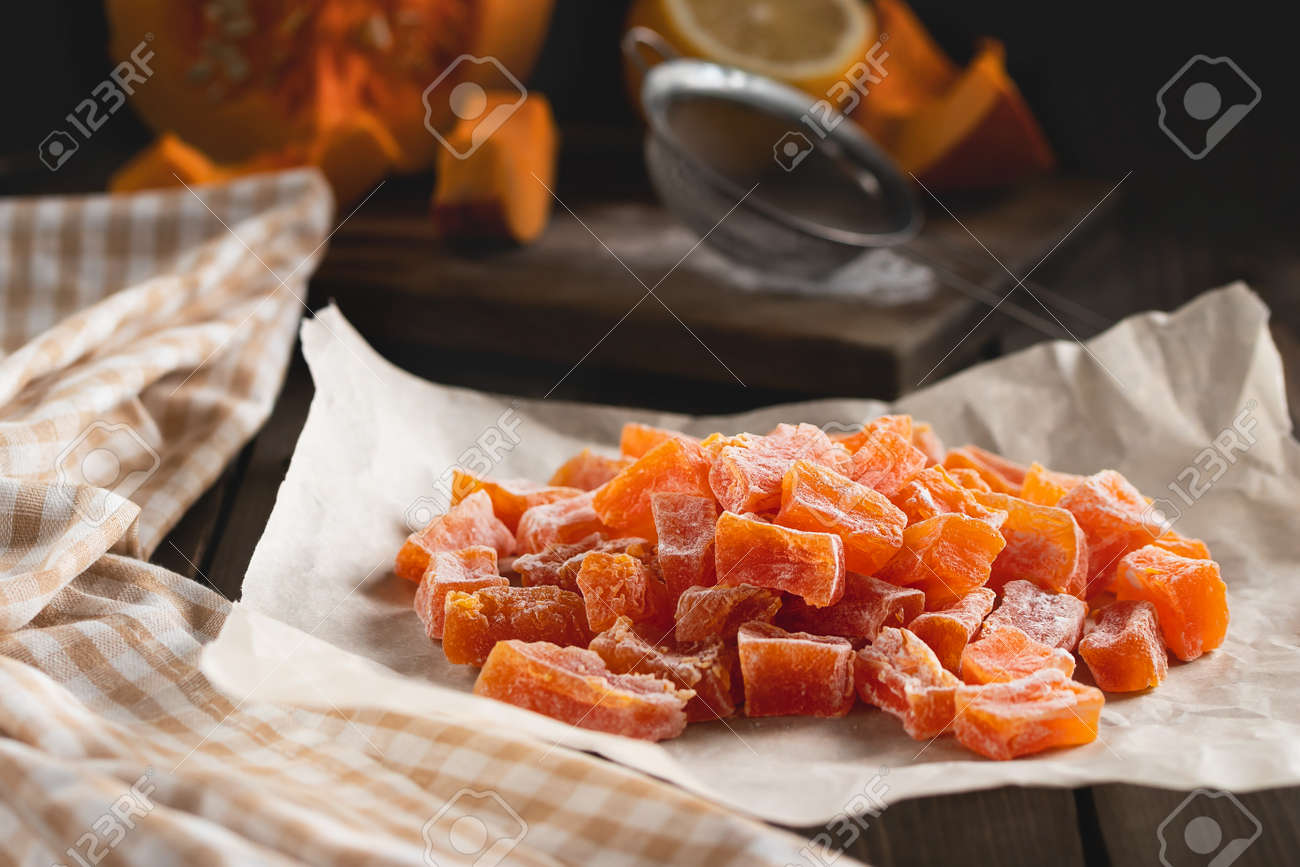 Cooking Natural farm homemade candied pumpkin fruits sprinkled with powdered sugar - 170093370