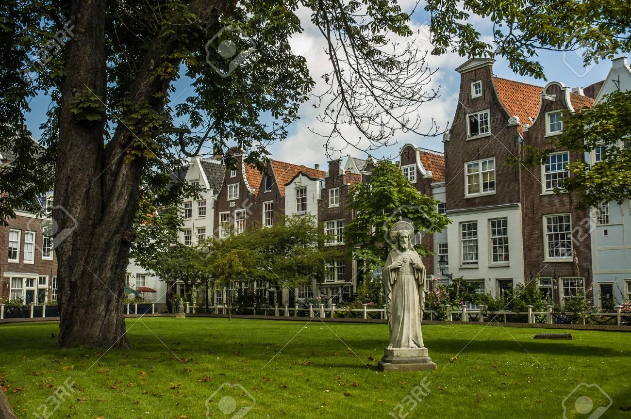 amsterdam garden near some typical houses netherlands stock photo 81221473 - Amsterdam Garden