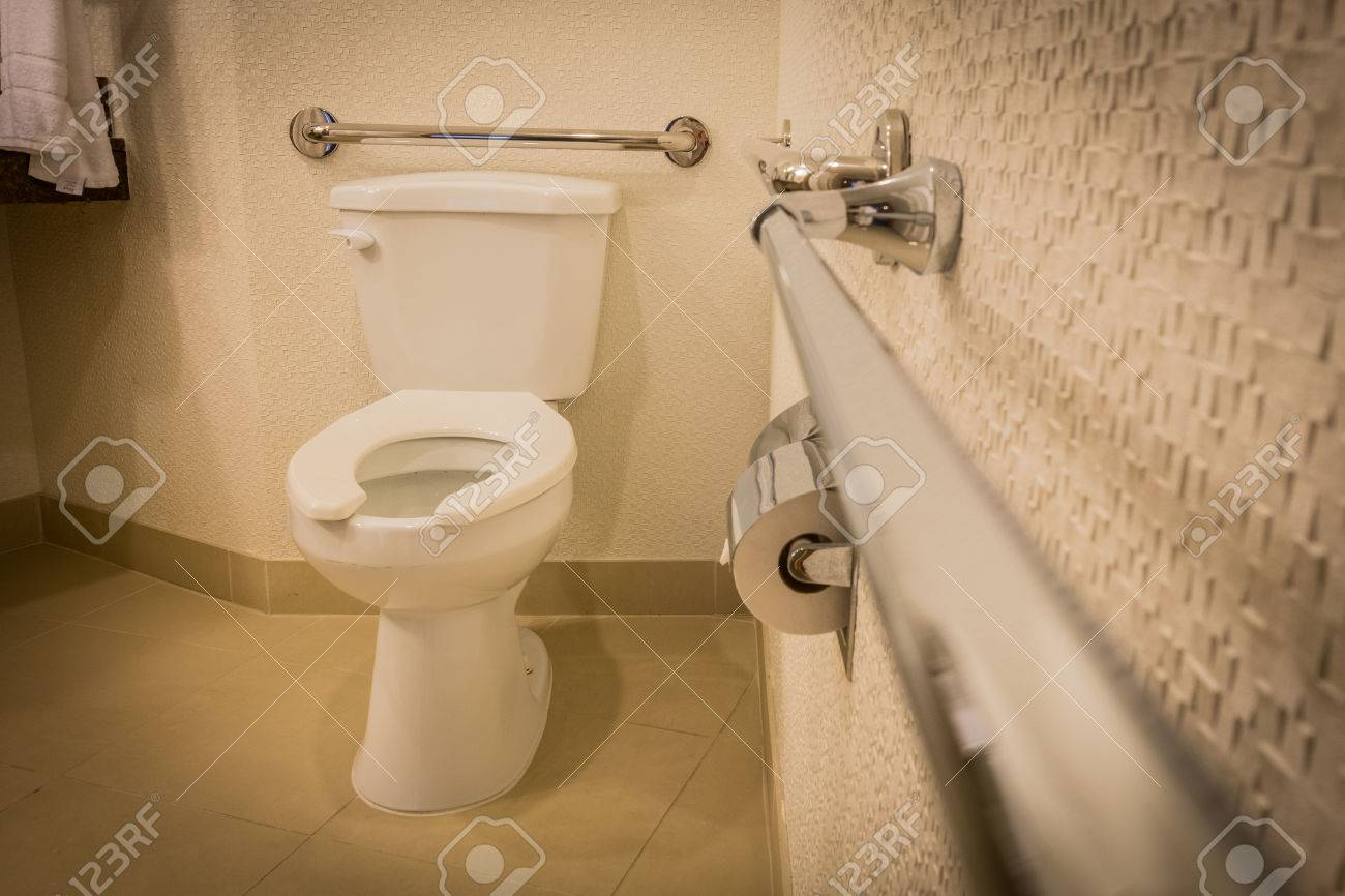 Disabled Toilet Bathroom With Grab Bars In White Interior Design ...