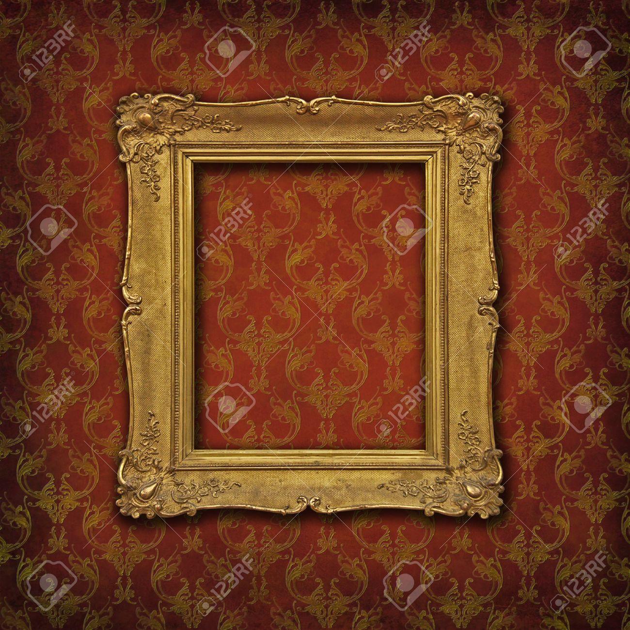 Empty vintage golden frame on a damask red ornated wallpaper Stock Photo - 14239654
