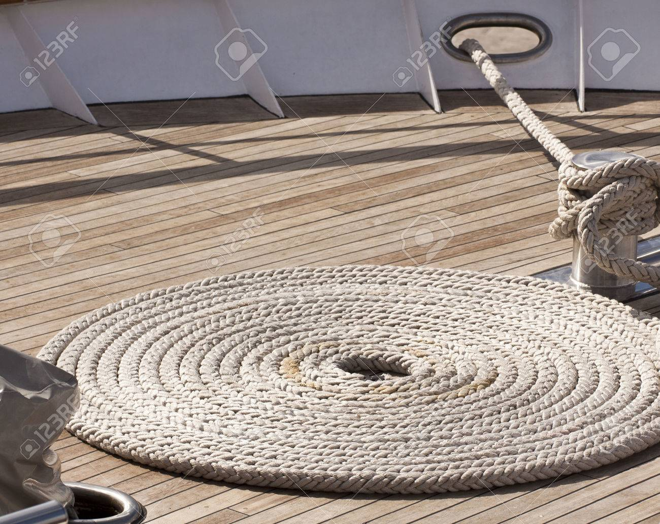 Yacht deck with anchor line in spiral shape Stock Photo - 33390805