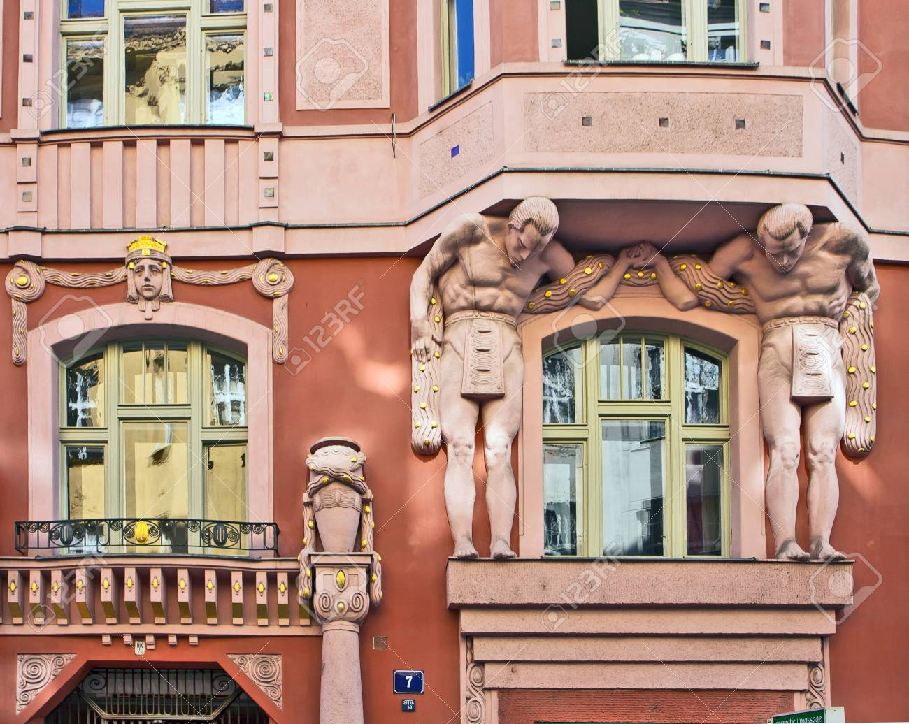 Art nouveau palace in Prague center, detail of figures and ..