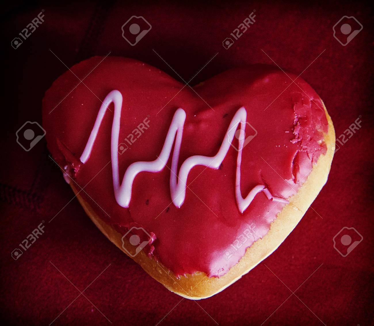 Doughnut heart shaped with glazed electrocardiogram decoration Stock Photo - 72550286