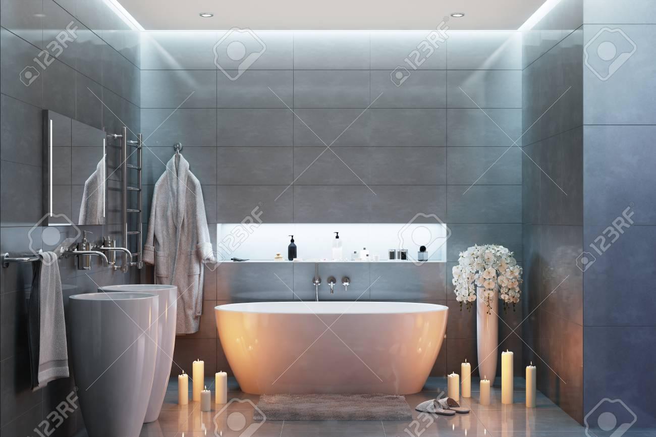 Salle de bains moderne gris dans la soirée