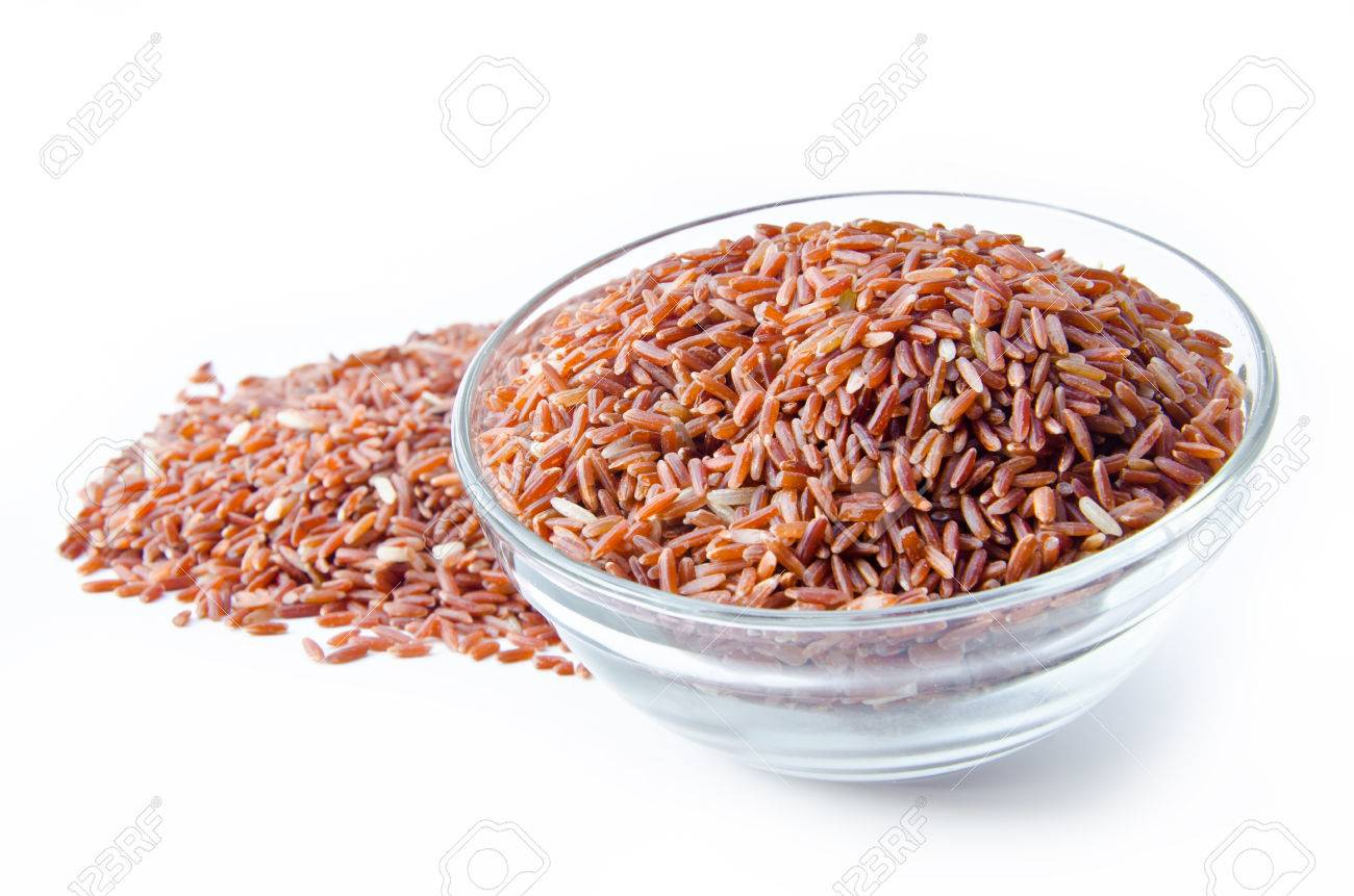 Bowl of raw brown rice on white background - 30837336