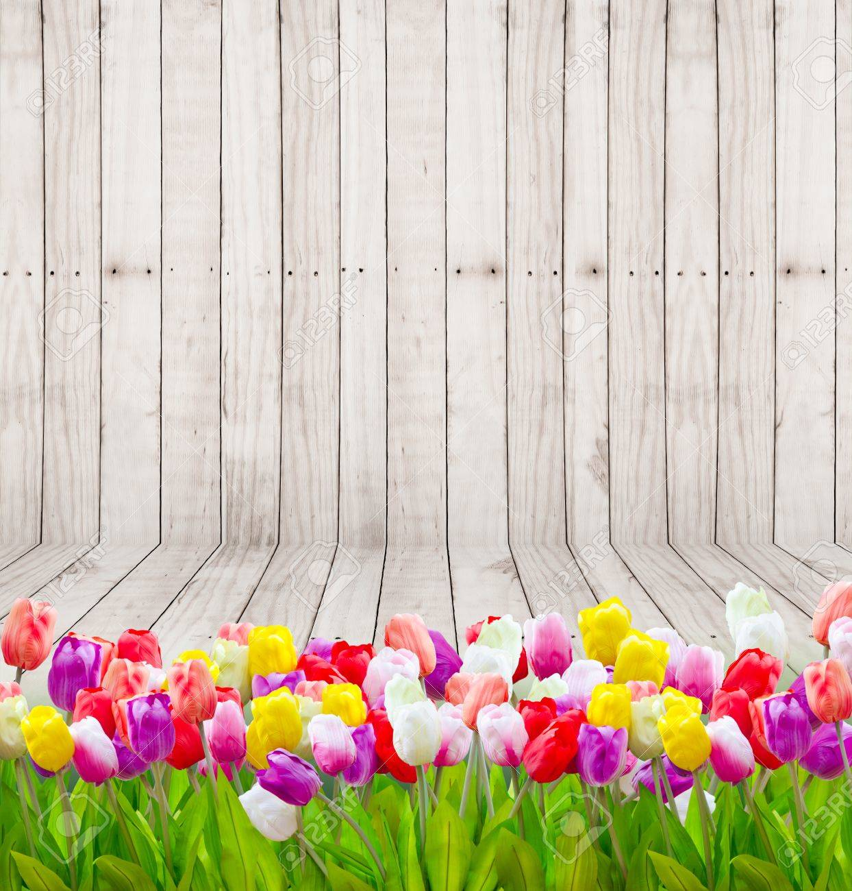 Bouquet tulip flowers on wooden wallpaper background. Stock Photo - 33038894