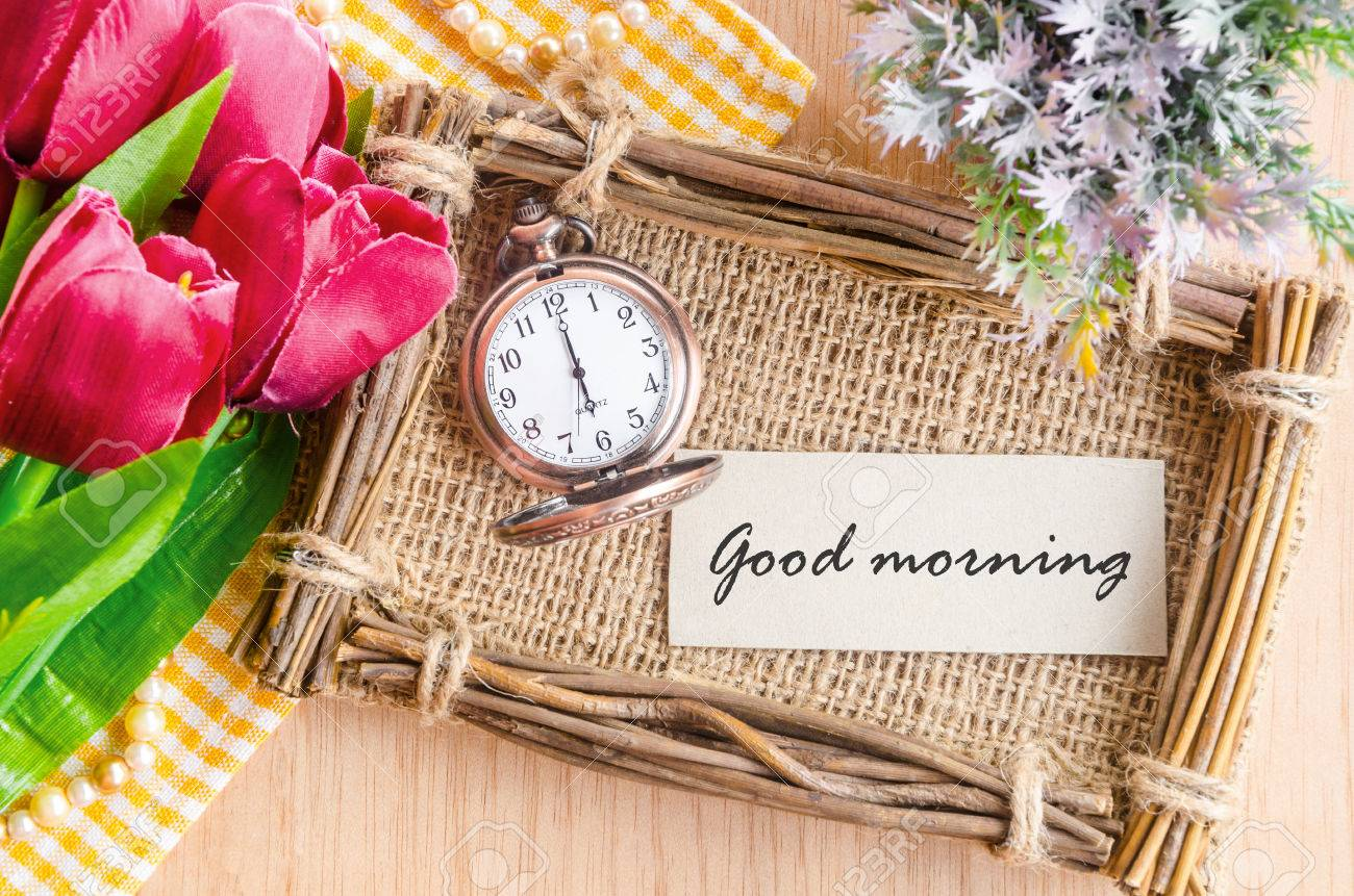 Good morning tag on sack photo frame with pocket watch and red good morning tag on sack photo frame with pocket watch and red tulip on wooden background jeuxipadfo Image collections