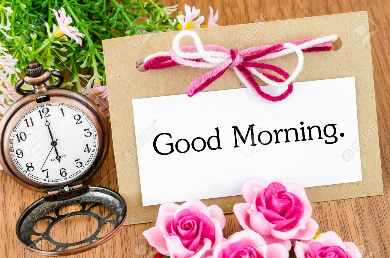 Good Morning In Greeting Card And Pocket Watch On Wooden Background