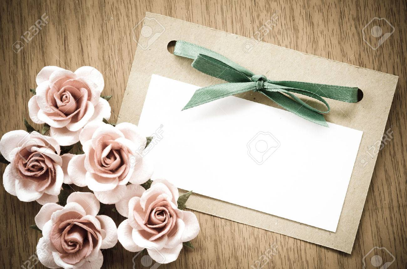 Vintage greeting card and rose flower on wooden background. - 42138194