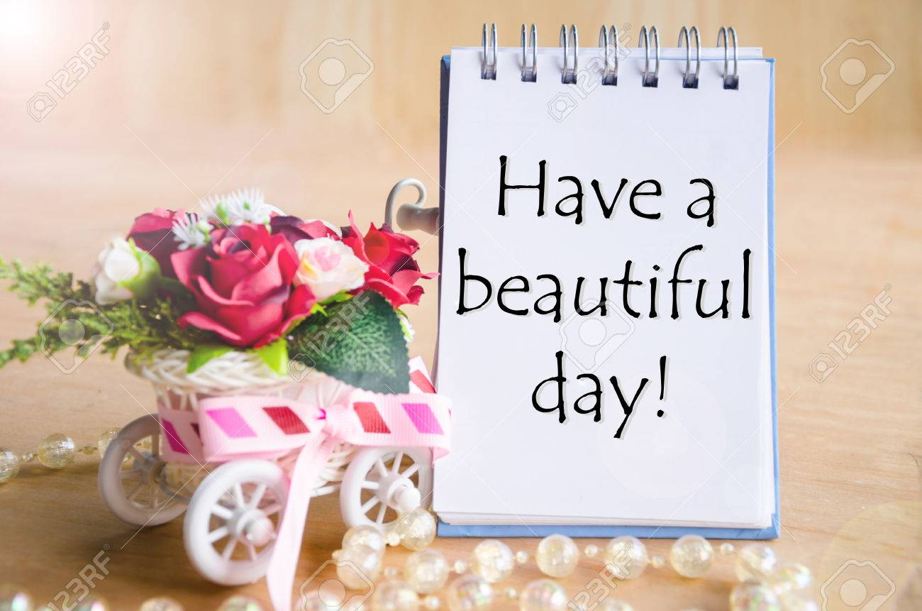 Have A Nice Day On Open Diary And And Red Rose Basket On Wooden
