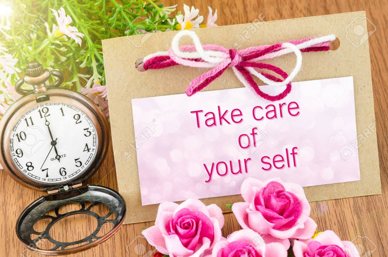 Take care of your self on tag and pocket watch with pink rose on wooden background. - 43296666