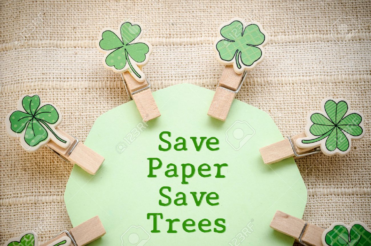 Save paper save trees on green paper and leaf wooden clamps on fabric background - 44441290