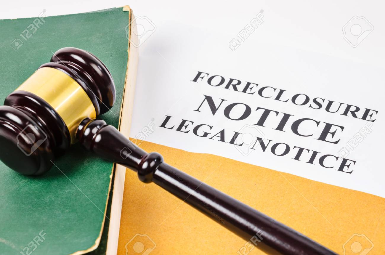 Gavel and Foreclosure Notice document with old book. - 85074392