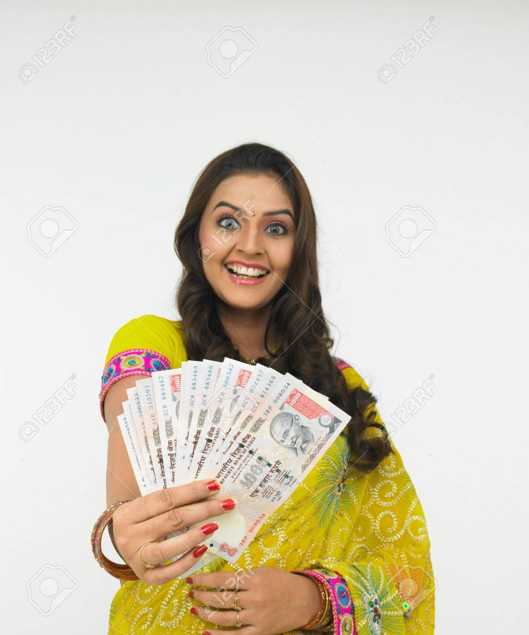 asian woman with a bunch of currency notes Stock Photo - 4282495