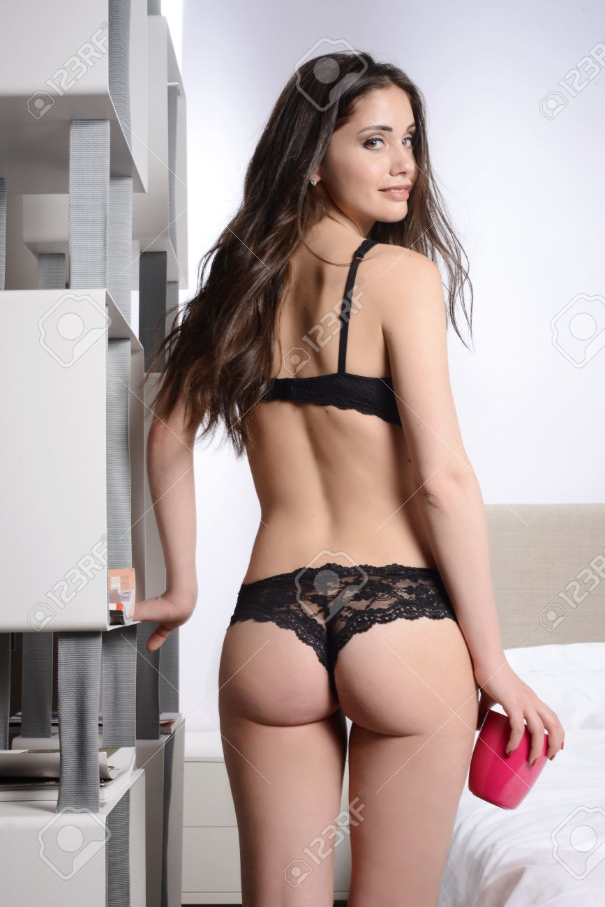 sensual woman for breakfast with sexy black lingerie stock photo