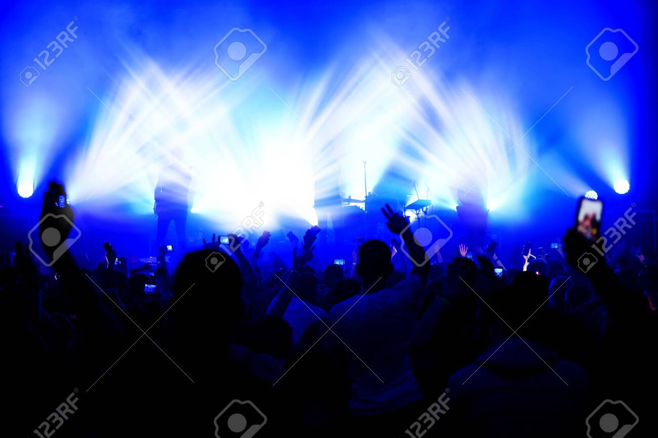 blurred view of the stage in the light of spotlights from the crowd at a concert. funny dances at a music festival. show poster - 149963694