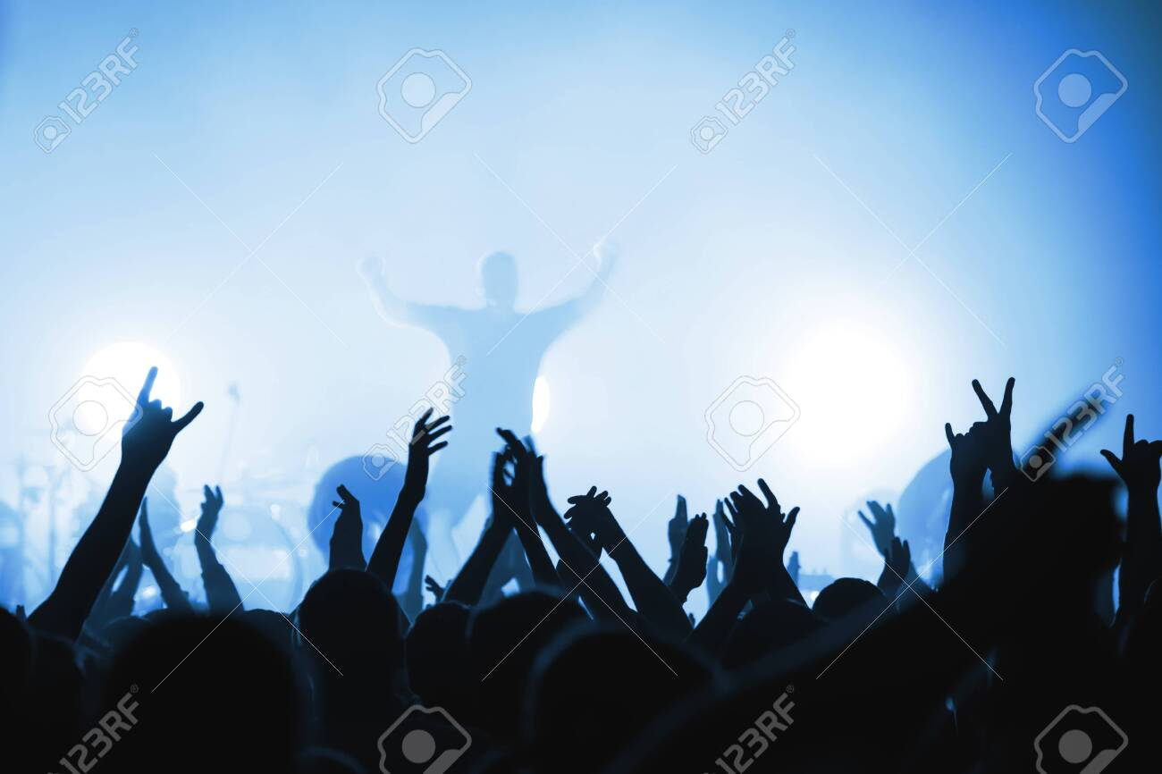 Blurred silhouettes of rock band musicians with beautiful lighting on stage and crowds at a concert. atmosphere of a music festival. light spotlights - 149964365