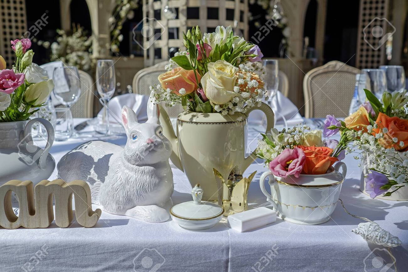 Wedding table decorated with garden flowers 1 - 135899723