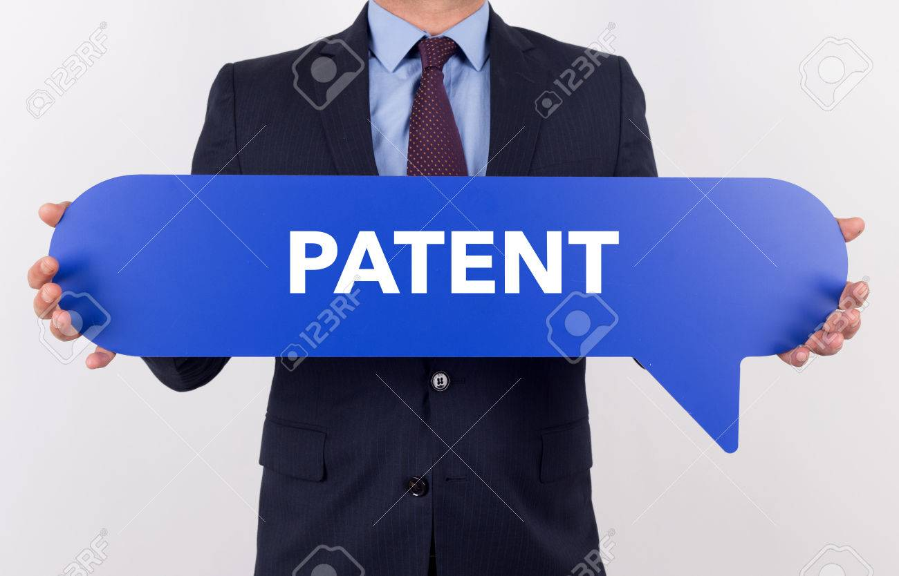 Businessman Holding Speech Bubble With A Word PATENT Stock Photo ...