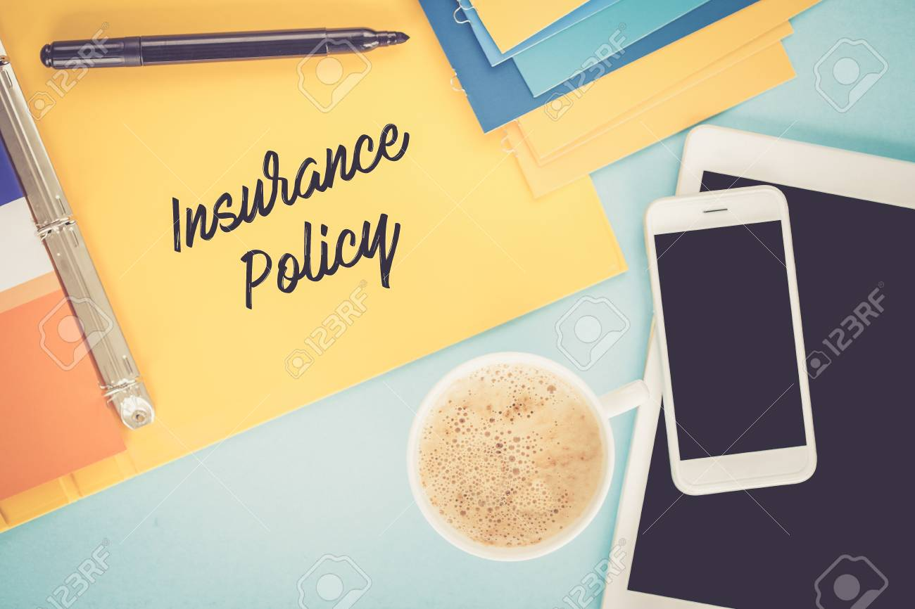 notepad on workplace table and written insurance policy concept stock photo 68675473