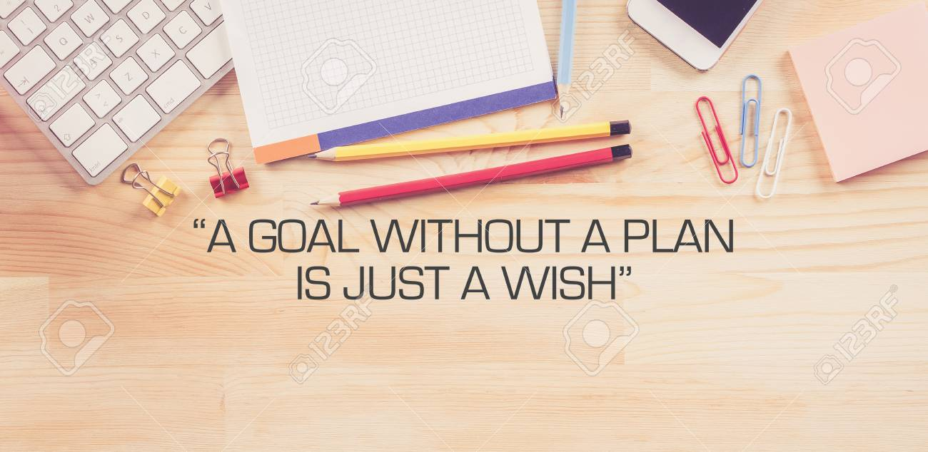 Business Workplace With A GOAL WITHOUT A PLAN IS JUST A WISH Concept On  Wooden Background