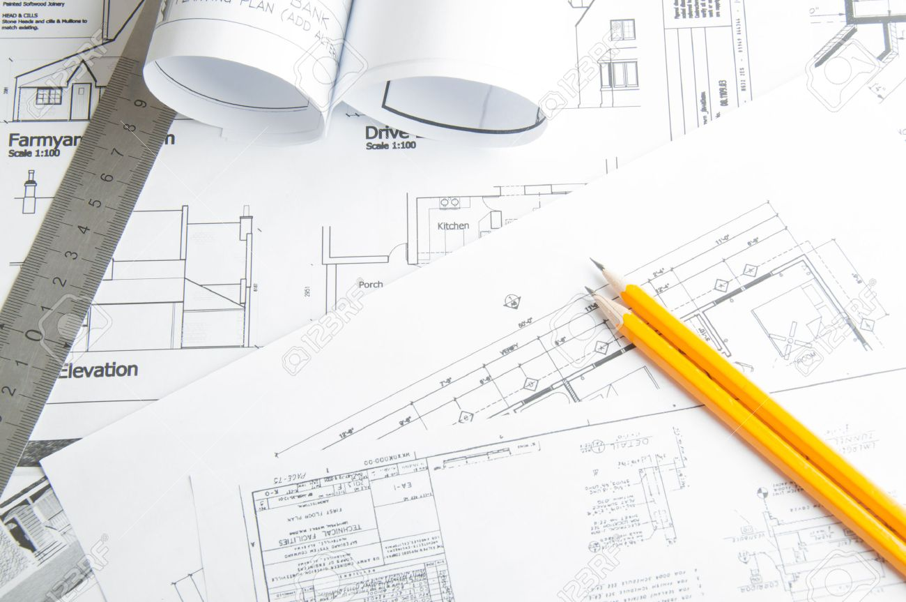 Construction planning drawings on the table and two yellow pencils - 35295502