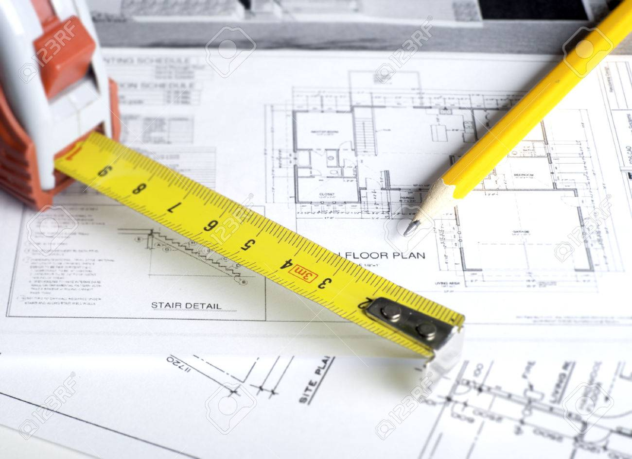 Construction planning drawings on the table and two yellow pencils - 35682736