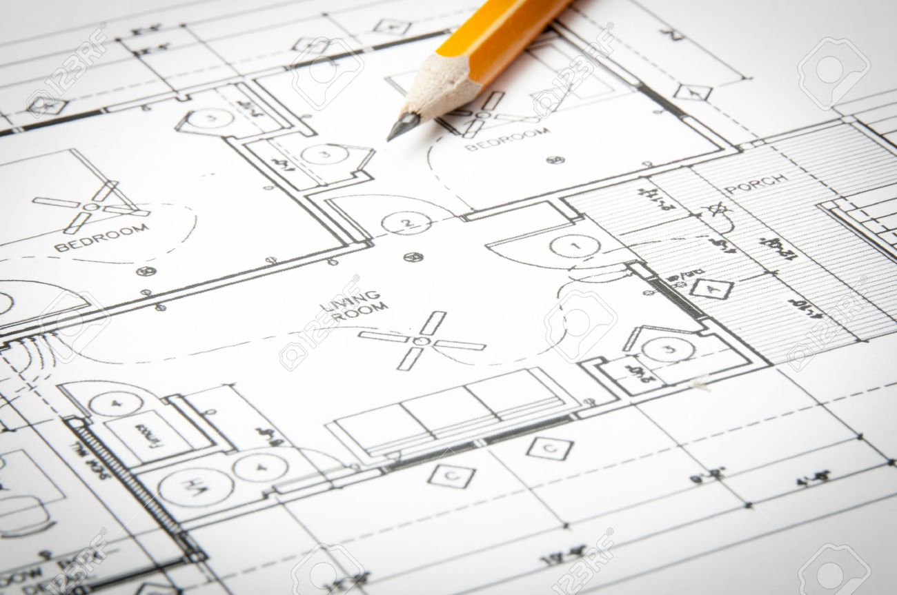 Construction planning drawings on the table and two yellow pencils - 35683355