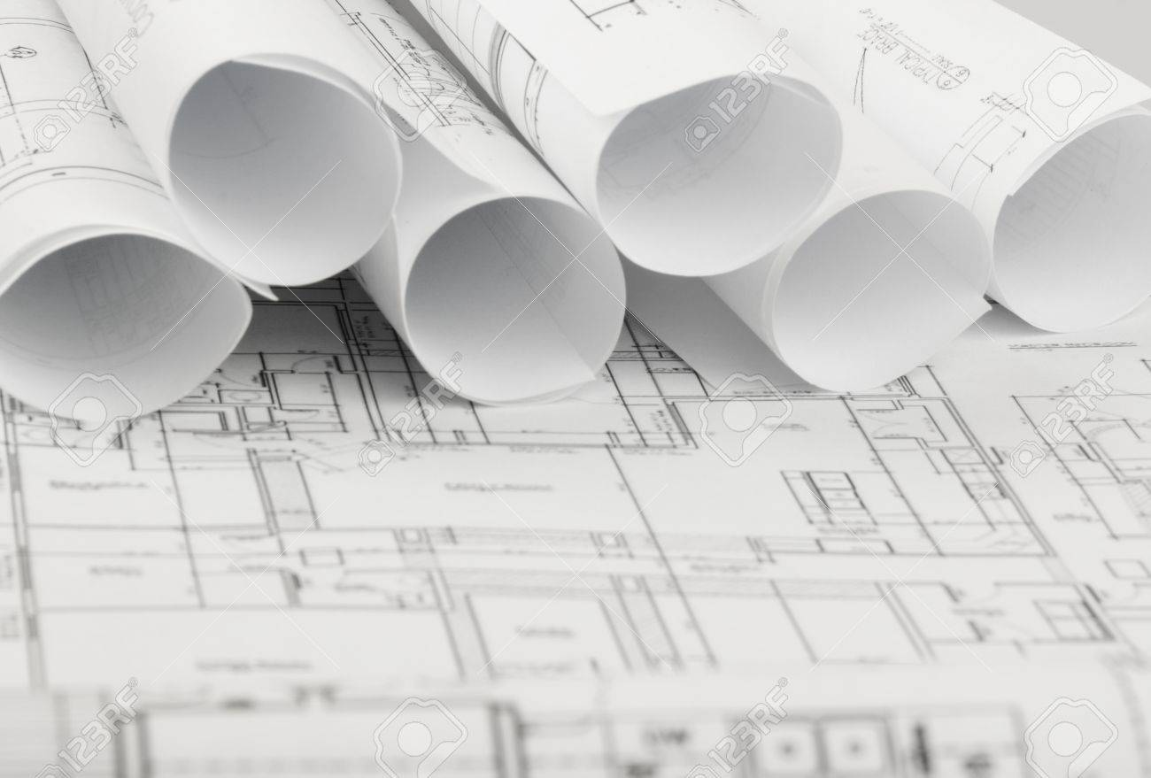 Architecture Blueprints rolls of architecture blueprints and house plans on the table
