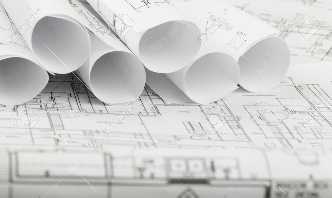 architecture blueprints home design ideas rolls of architecture blueprints and house plans on the table