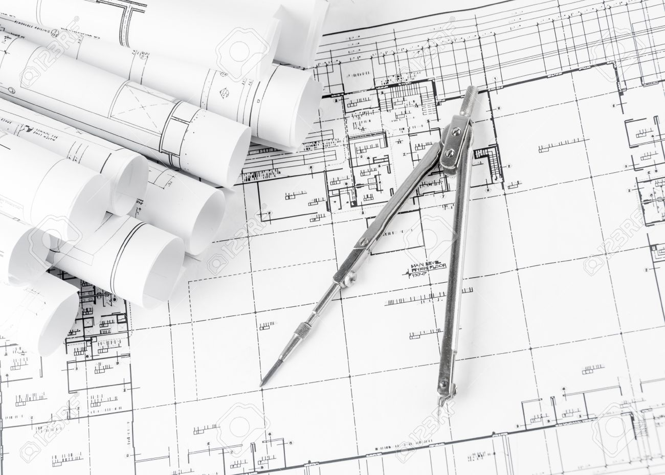 Architecture blueprints Factory Rolls Of Architecture Blueprints And House Plans On The Table And Drawing Compass Stock Photo Wikipedia Rolls Of Architecture Blueprints And House Plans On The Table