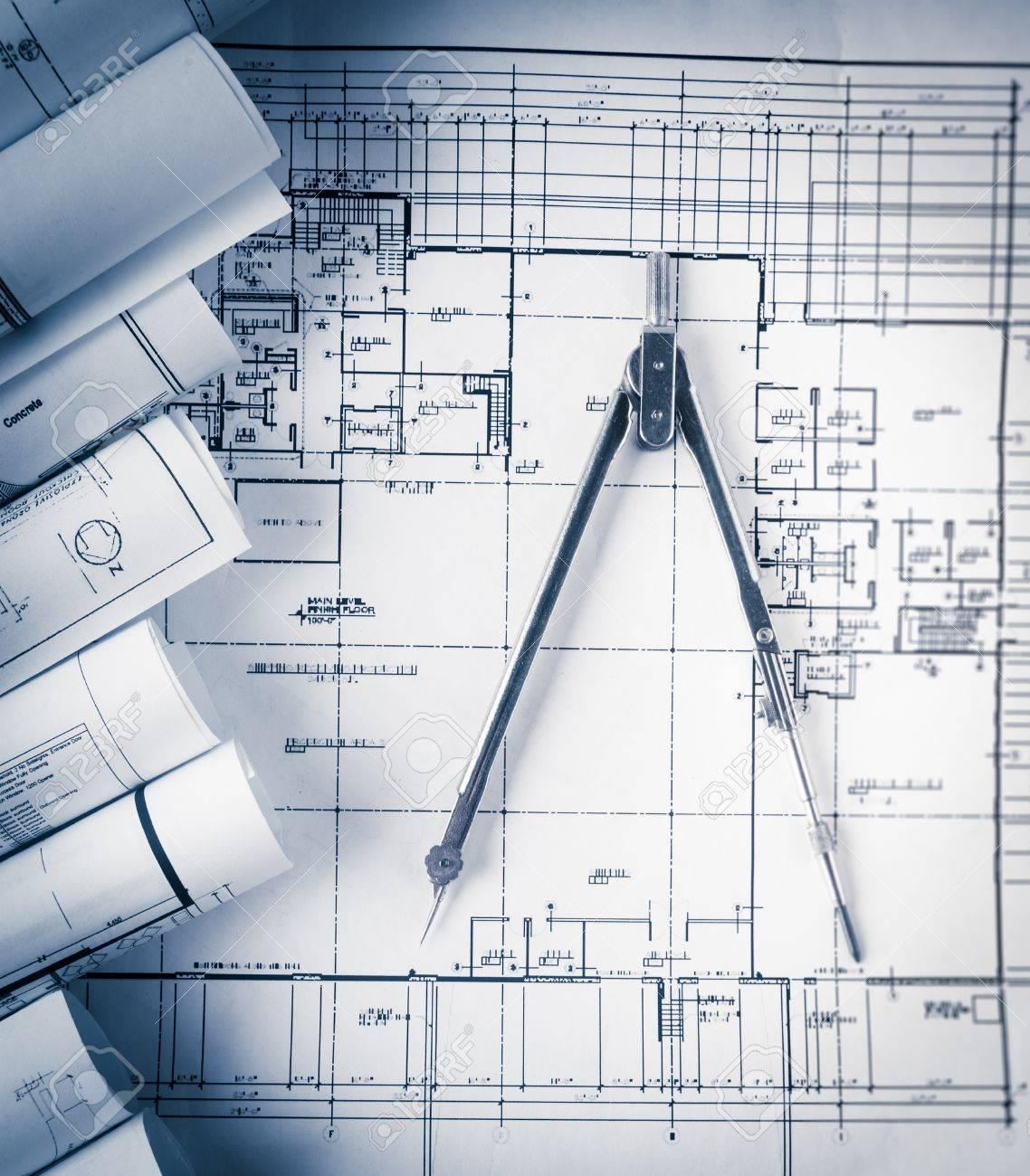 Blueprint house plan architecture royalty vss pro rolls of architecture blueprints and house plans on the table 41611301 rolls of architecture blueprints and house plans on the table and drawing compass malvernweather Images
