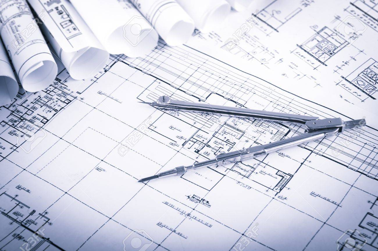 Rolls of architecture blueprints and house plans on the table rolls of architecture blueprints and house plans on the table and drawing compass stock photo malvernweather Images
