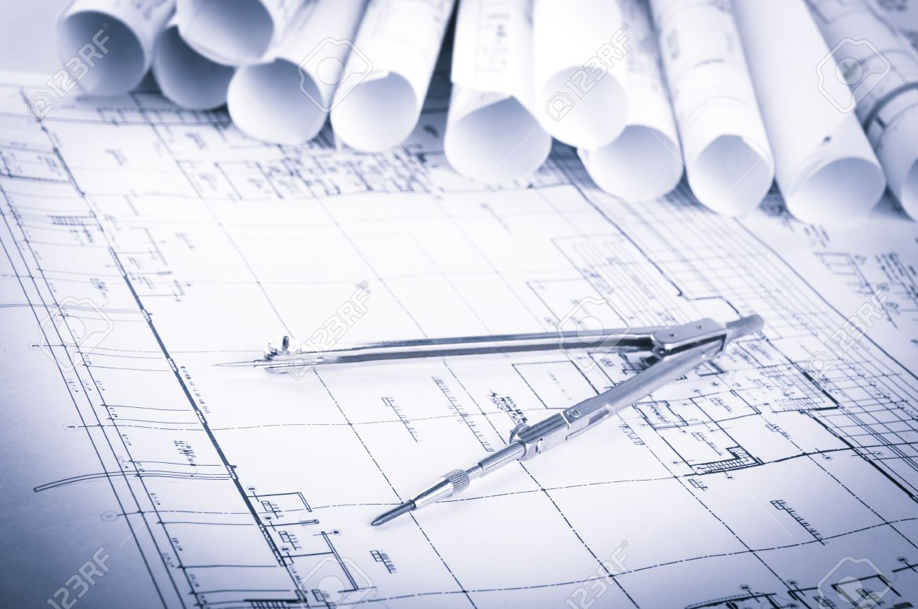 architecture blueprints. Rolls Of Architecture Blueprints And House Plans On The Table Drawing Compass Stock Photo -