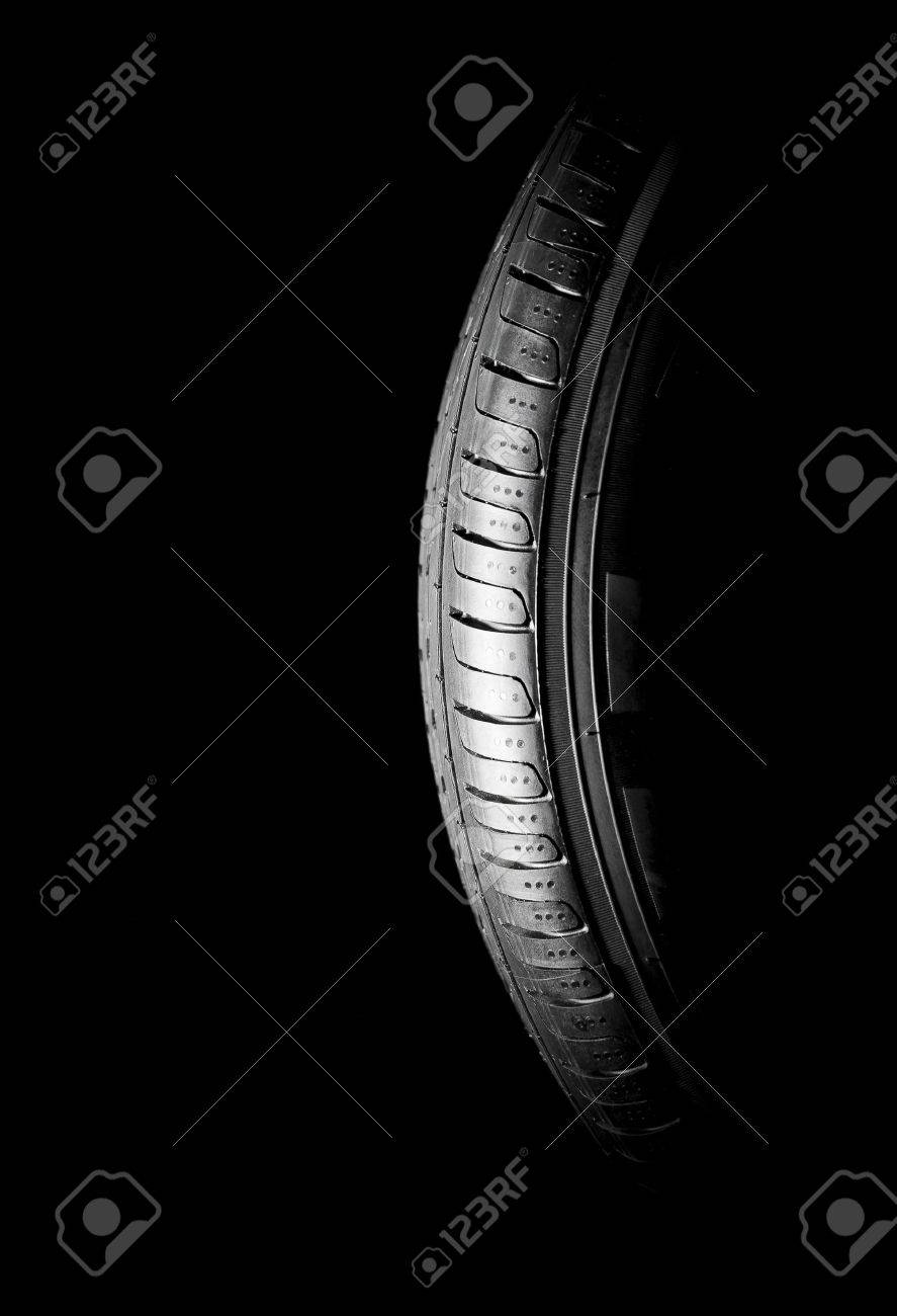 Car tires close-up Winter wheel profile structure on black background - 57201462