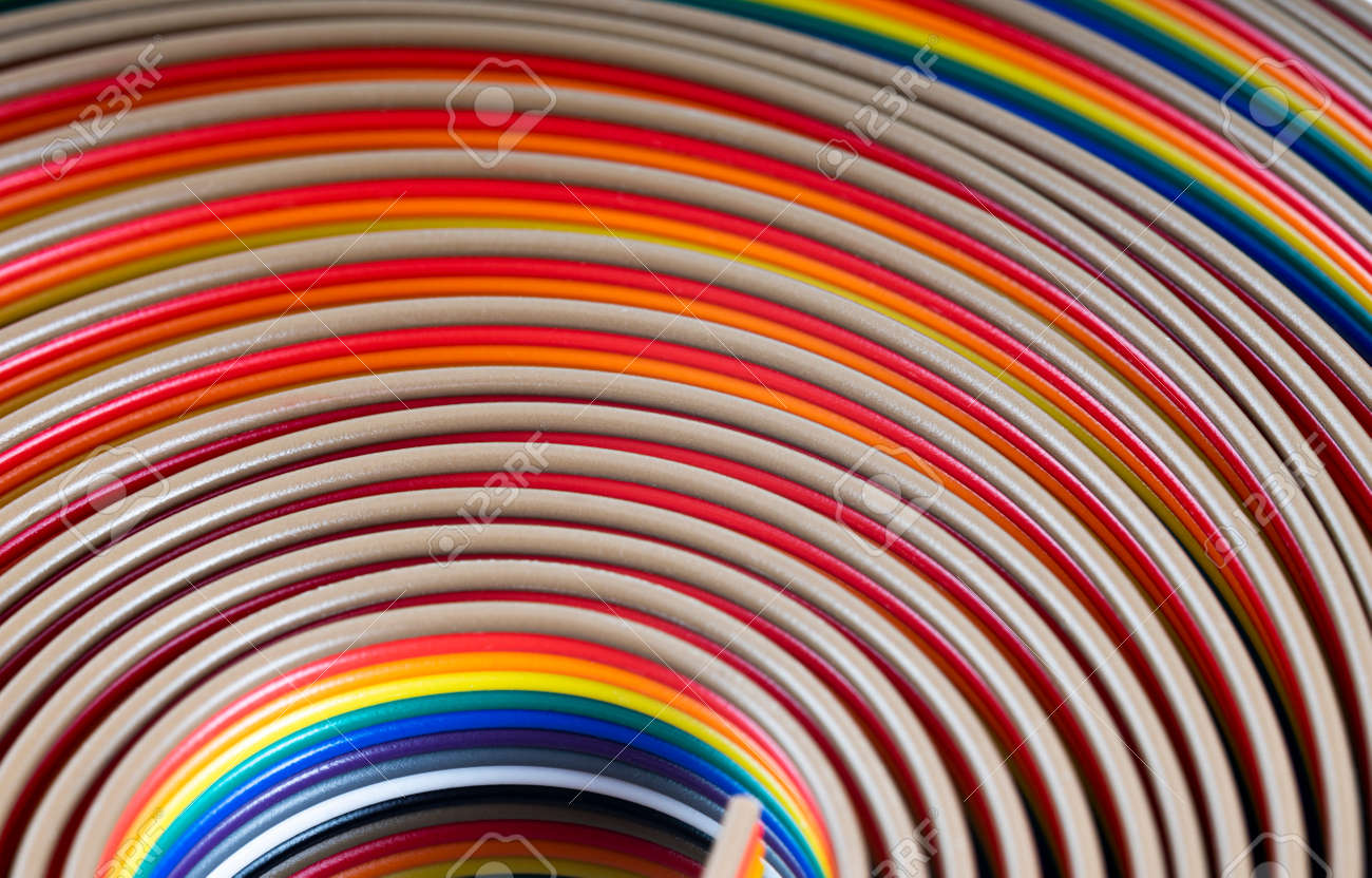 Cable and wires rainbow colored blurred close-up, macro shot, Texture or background. wires color background - 166245389